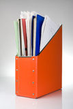 Orange documents folder. Documents folder with papers, reflection on white background Stock Image