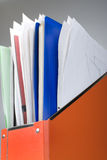Orange documents folder. With lot of papers Royalty Free Stock Images