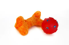 Orange Dog Bone Toy and Red Ball Stock Images