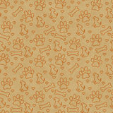 Orange Doggy Tile Pattern Repeat Background. Orange Dog Paw Prints, Puppy, Bone and Hearts Tile Pattern Repeat Background that is seamless and repeats Royalty Free Stock Image