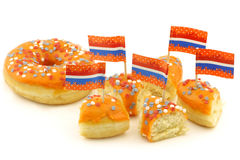 Orange donut pieces with red,white and blue sprink Stock Photos