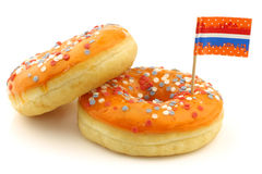 Orange donuts with red,white and blue sprinkles Stock Image