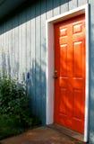 Orange Door. Door of a home painted bright orange Royalty Free Stock Photography