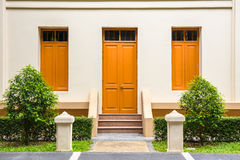 orange Door , orange window on Cream Wall on orange staircase wi Royalty Free Stock Photography