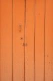 Orange door Stock Images