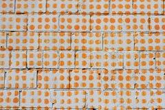 Orange dots on white brick wall. As background or texture stock photos