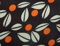 Orange dots and white leafs in brown background pattern. Orange dots and white leafs in brown background pattern on fabric Stock Photos