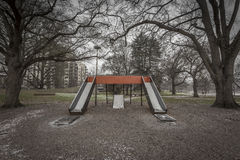Orange double slide on a wintery day Royalty Free Stock Images