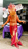 Orange dragon costume at faerie festival Royalty Free Stock Photography
