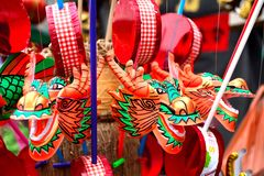Orange Dragon Heads. Dragon head chinese-look toys are waiting for children in front of shrine during anniversary of the goddess of mercy Royalty Free Stock Photo