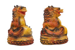 Orange dragon statuette. Stock Photos