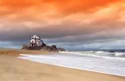 Orange dream. Miramar beach and the \Sr. da Pedra\ Chapel - Portugal Royalty Free Stock Photography