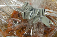 Orange dried fruit and pastries in cellophane packaging -Mikvah Stock Images