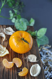Orange with Dried Plant on Wooden Board Royalty Free Stock Photos