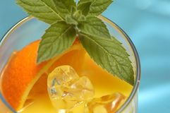 Orange drink. And mint Royalty Free Stock Photography