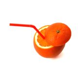 Orange drink. Fresh ripe orange cutted on top with straw on white background Royalty Free Stock Image