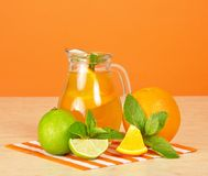 Orange drink, citrus, mint and striped Stock Photography