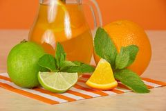 Orange drink, citrus, mint and striped napkin on a Stock Photos