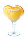 Orange drink in crystal wineglass Stock Photos