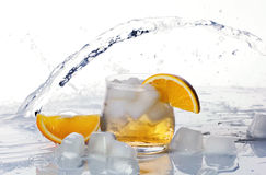 Orange drink with ice Stock Image