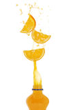 Orange drink splash Royalty Free Stock Images