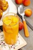 Orange drink on wooden table Stock Photos
