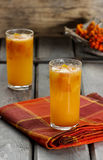 Orange drink on wooden table Royalty Free Stock Photo