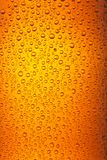 Orange drops. Ice, drops and water droplets abstract image which may be used as a background or wallpaper Stock Images