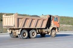 Orange Dump Truck. An Orange Dump Truck loaded of cement Stock Image