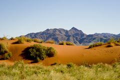 Typical landscape of Namibia, orange dunes with mountains in back, Namibia, Africa Royalty Free Stock Image