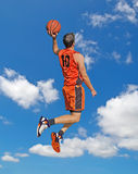 Orange dunk in the sky Royalty Free Stock Photo