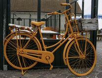 Orange dutch bicycle leaning onto  a wall Stock Photos