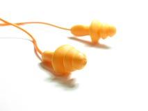 Orange ear plug Stock Photography