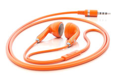 Orange earphones Stock Photo