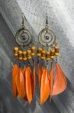 Orange earrings stock photography