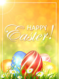 Orange Easter background with colored eggs Royalty Free Stock Photos