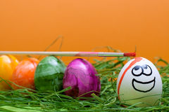 Orange easter background with funny egg Royalty Free Stock Photo