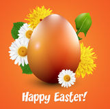 Orange Easter egg with spring flowers Royalty Free Stock Image