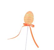 Orange easter egg on a stick. Royalty Free Stock Photo