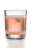 Orange effervescent tablet in a glass of water. Stock Photography