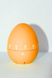 Orange egg timer in front of white background Stock Images