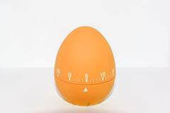 Orange egg timer in front of white background Royalty Free Stock Image