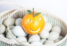 Orange and eggs Stock Photography