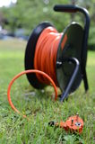 Orange electric cable. In the garden Stock Image