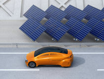 Orange electric car driving on the highway Stock Images