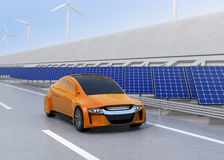 Orange electric car driving on the highway Stock Image