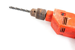 Orange electric drill in. White Royalty Free Stock Photography