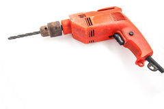Orange electric drill in. White Royalty Free Stock Images