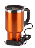 Orange electric thermos mug for auto lighter Stock Image