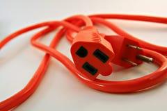 Orange Electrical Cord. An orange electrical cord on white Stock Photo